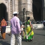 Locals wearing colorful outfits around the Gate