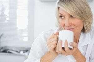 Woman enjoying mug of tea.