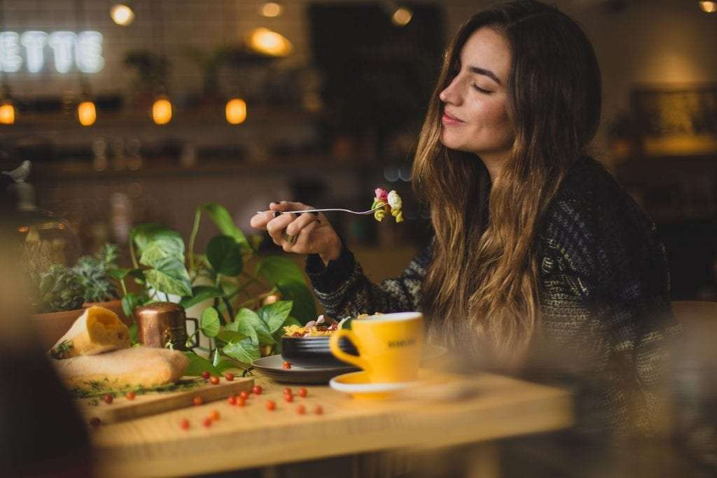 Woman enjoying her food photo